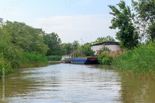 Fotografie, Obraz  Danube river and view of the small house and barge on a summer day