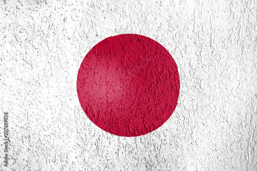 Texture of the flag of Japan on a wall of plaster. #207659036