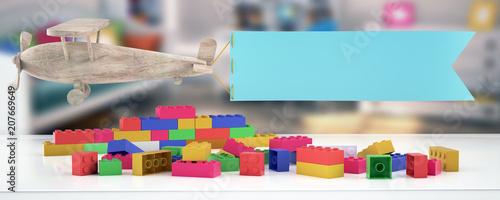 Obraz Plastic building blocks,plane and blur background - fototapety do salonu