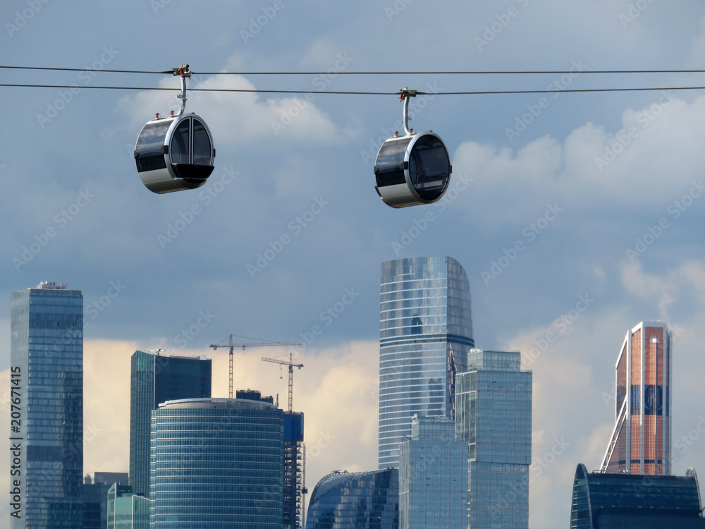 Fototapety, obrazy: New cable car cabins in the Luzhniki against skyscrapers of Moscow-city in Russia