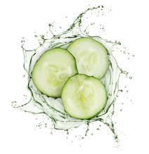 Cucumber Slices Rotate In Splashes Of Juice On White Background