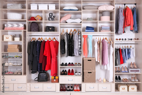 Obraz Large wardrobe with different clothes, home stuff and shoes - fototapety do salonu