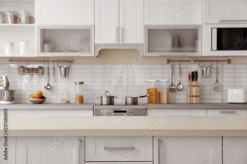Countertop and blurred view of kitchen interior on background Tablou Canvas
