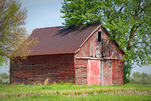 An Abandoned Farm Barn Sits In...