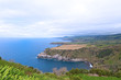A sweeping view from one of scenic outlooks on Sao Miguel Island of Azores, Portugal. Azorean landscape of the southern coastline of the island in spring.