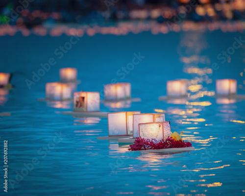 Photo  Floating prayer lanterns in water Honolulu, Hawaii 2018