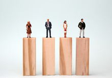 Miniature Men And Women Standing On The Same Height Block. Theconceptofequalopportunitiesforgender.