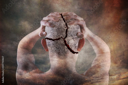 Fotografering  Teenager holding his head that is cracking concept of mental health