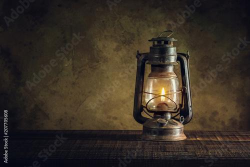 kerosene lamp oil lantern burning with glow soft light on aged wood floor Wallpaper Mural