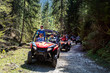 canvas print picture - A tour group travels on ATVs and UTVs on the mountains