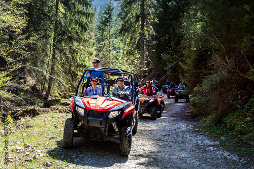 Photo  A tour group travels on ATVs and UTVs on the mountains