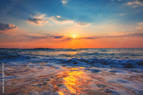 Tuinposter Cappuccino Beautiful sunrise over the sea