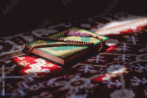 Fotografie, Obraz  prayer beads on Koran holy book of Muslims