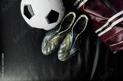 Vászonkép Flat lay soccer football accessories on a dark leather background