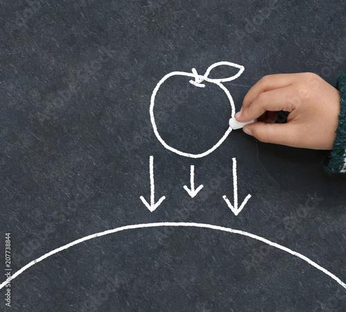Canvas-taulu Enfant dessinant une pomme en gravitation