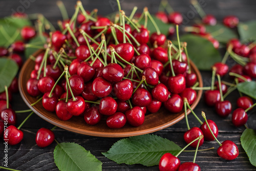 Obrazy owoce tasty-juicy-sweet-cherry-on-a-wooden-background-it-can-be-used-as-a-background