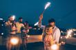 Leinwanddruck Bild - Group of happy friends celebrating at rooftop