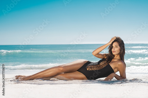 Beautiful woman lying on sand