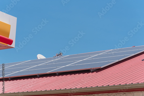 Close-up solar panel on metal roof of commercial building at