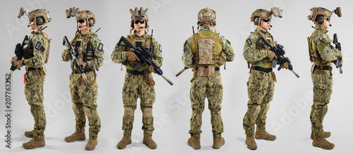 Fotografiet Special forces soldier with rifle on white background.