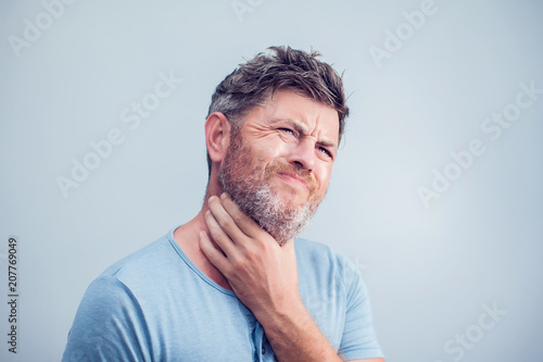 Fotografía People, healthcare and problem concept - unhappy man touching his neck and suffe