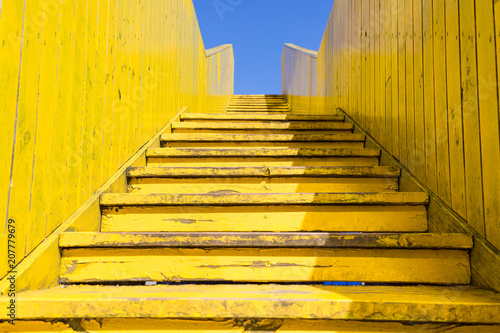 Staande foto Rotterdam Yellow stairs of the wooden Luchtsingel bridge, Rotterdam, Netherlands with blue sky in summer