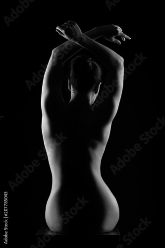 Foto op Canvas Akt Art nude, perfect naked back, sexy woman on dark background, black and white studio shot