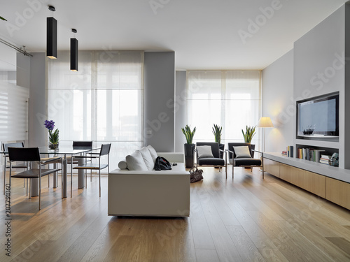 Fotografía  modern living room interior  in the foreground the leather sofa and the glass di