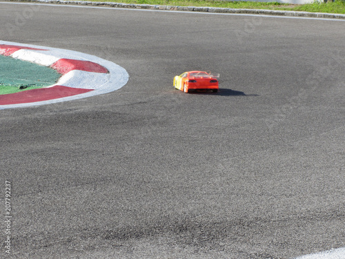 Foto op Plexiglas F1 Small radio controlled model car on the track . Miniature remote controlled sport racing cars hobby