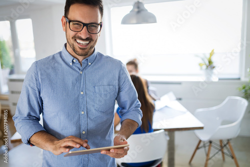 Portrait of handsome male company trainee in office
