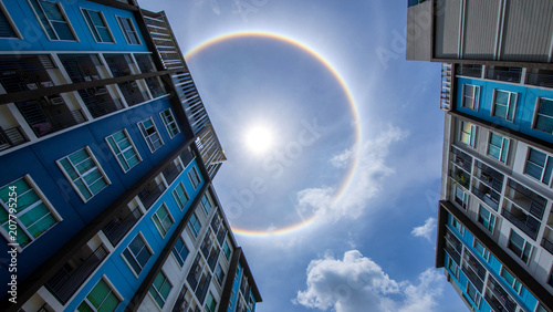 sun corona rainbow clouds and blue sky background , Circumscribed halo