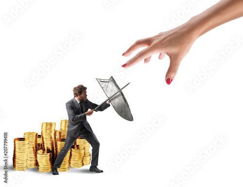 Obraz na plátně Business man protects financial capital from the tax office fighting with sword and shield