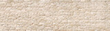 Fototapeta Rocks - Beige old brick wall panorama.