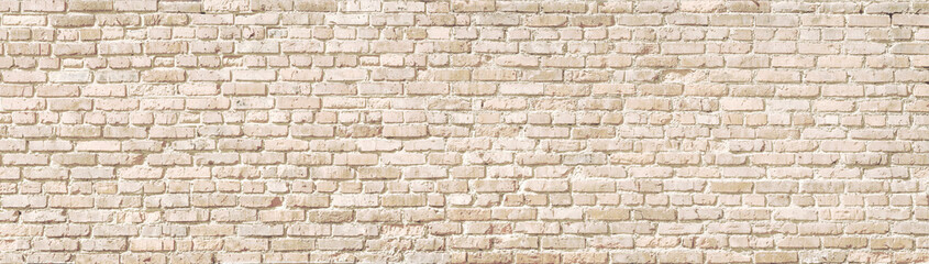 Beige old brick wall panorama.