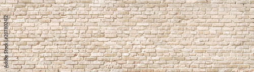 Poster de jardin Graffiti Beige old brick wall panorama.