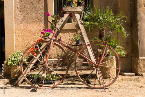 Foto op Canvas Fiets Retro bicycle coded with flowers on a sunny day