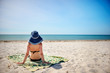 young woman in a blue hat Relaxing At Tropical Beach