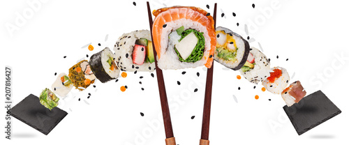 Tuinposter Sushi bar Pieces of delicious japanese sushi frozen in the air.