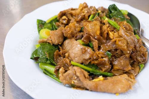 Stir fried ribbon noodle with pork and vegetable