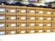 Row Of Shoes Box And Shoes Stacked In Store