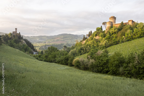 Fotobehang Wit Green valley in italian hills with two castles