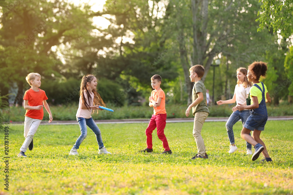 Fototapety, obrazy: Cute little children playing with frisbee outdoors on sunny day