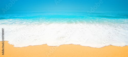 Staande foto Strand Beautiful Tropical beach with Soft wave of blue ocean, sand and transparent sky. Summer travel holiday background concept. Sea panorama.