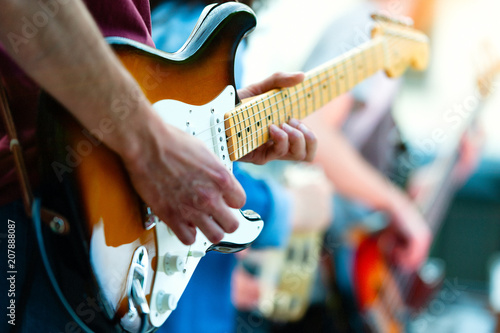 Detail of guitarist of a pop group during a show - 207888087