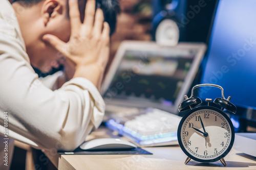 Fotografie, Obraz  tired & headache asian businessman work overtime
