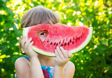 A Child Eats Watermelon. Selec...