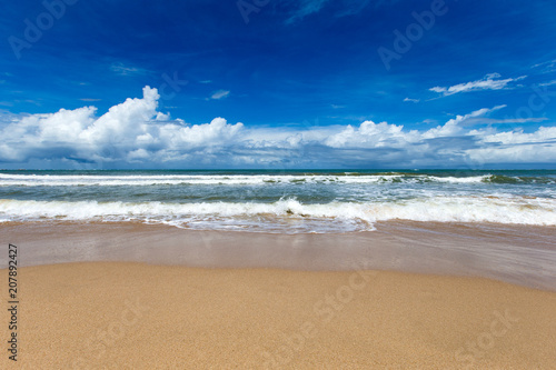 Sea view from tropical beach with sunny sky Wallpaper Mural