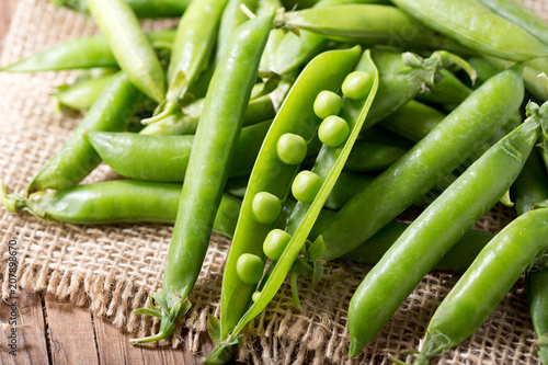 green peas pod on wooden table