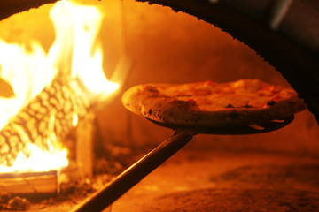 Neapolitan pizza in a wood stove