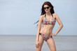 young girl in bikini against the sea